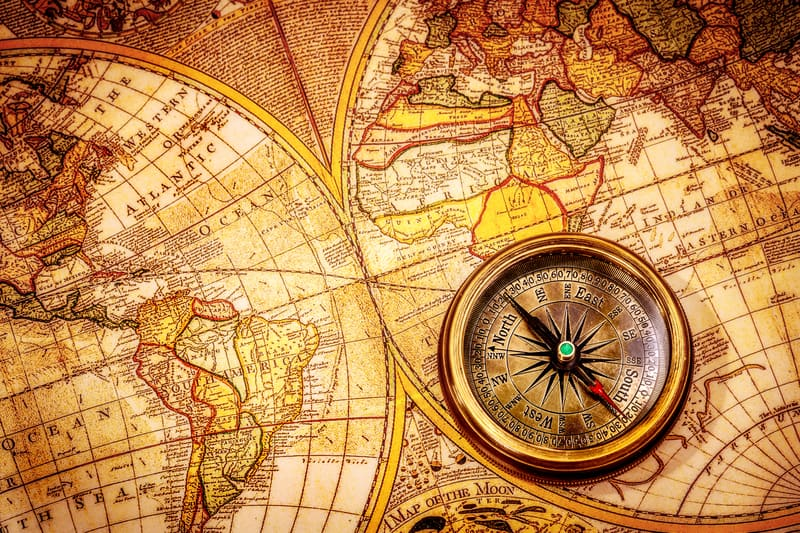 © Andrey Armyagov | Dreamstime.com - Vintage compass lies on an ancient world map.